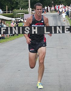 Jed Christiansen crossing 5k finish line