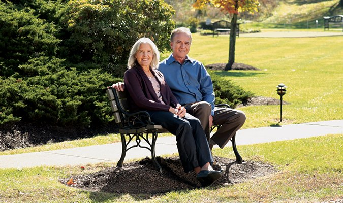 St. Barnabas couple sitting on bench