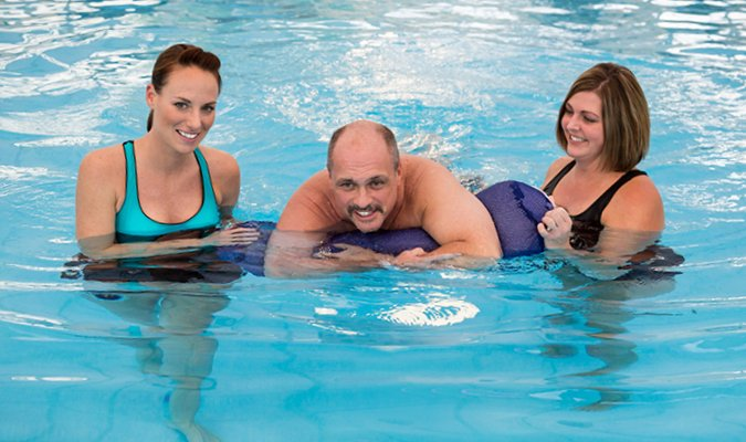 Aqua therapy patient in the pool at St. Barnabas