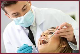 Dentist performing dental exam