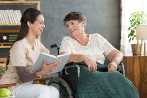 Caregiver reading book for senior