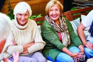 Seniors on bench talking