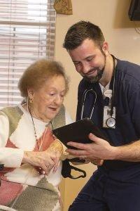 Nurse assists elderly resident