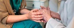 Nurse Holding A Hospice Patient's Hand